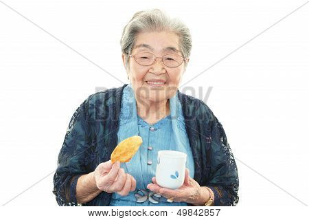 Old woman eating snack