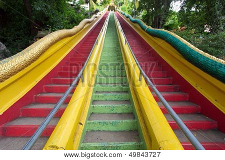 Colorful stairs of the wat tham khao noi buddhist temple in Kanchanaburi province, Thailand