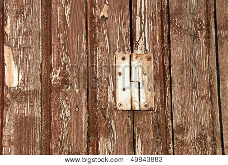 Hinge On A Wooden Background