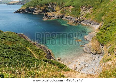 Secluded beach and cove with turquoise sea Black Head headland St Austell Bay