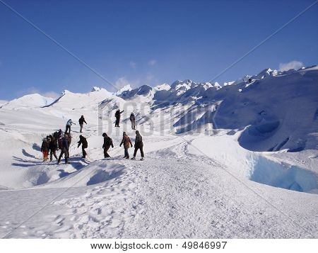 Group of people trekking on top of glacier Perito Moreno