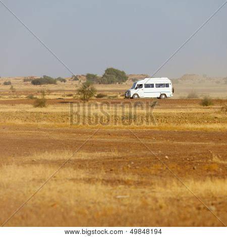Bus Carries Tourists To The Rocky Desert. India