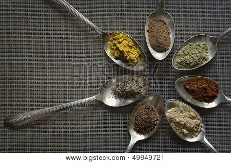 Spices In Old Silver Spoons