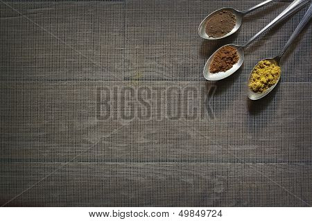 Three Antique Silver Spoons with Different Spices in Each