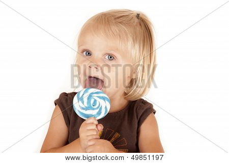 Blue Eyed Toddler With A Blue Swirl Sucker