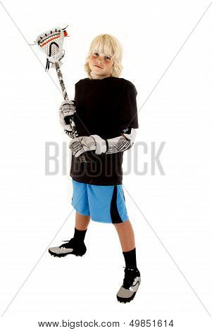 Young Boy In Lacrosse Outfit With Stick Ready To Play