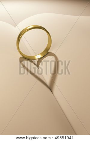 A ring and a heart shadow on a book