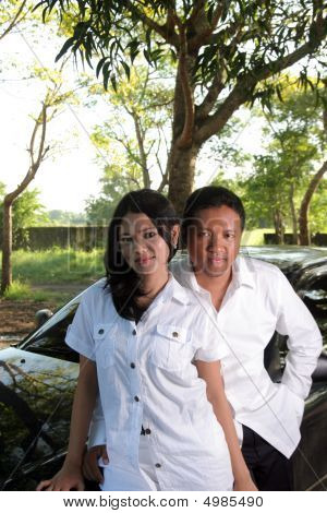 Portrait Of Prosper Couple Outdoor On Car