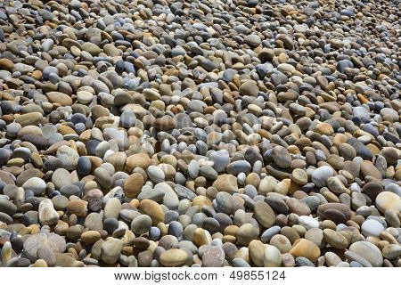 colorful pebble stone background, at the beach