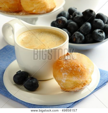 Cup Of Coffee With Profiteroles And Blueberries