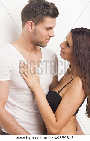 Young sexy heterosexual couple embracing