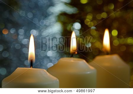 Candles With A Sparkling Tinsel Background