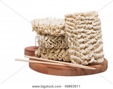 Ramen Instant Raw Noodles On Vutting Board 3/4 With Chopsticks
