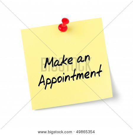 Yellow paper note with text Make an Appointment