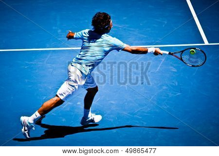 MELBOURNE, AUSTRALIA - JANUARY 25: Roger Federer inhis win over Lleyton Hewitt during the 2010 Australian Open on January 25, 2010 in Melbourne, Australia