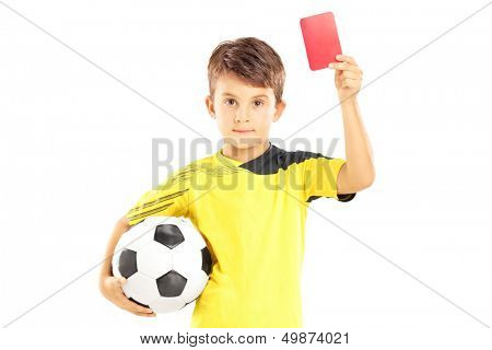 Kid in sportswear holding soccer ball and giving red card isolated on white background