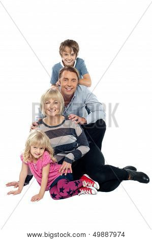 Closely Bonded Family In A Studio