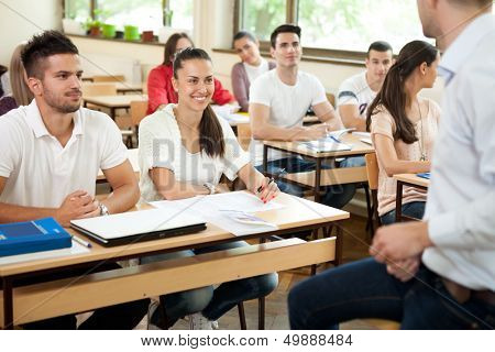 students listening to a university lecture with tutor