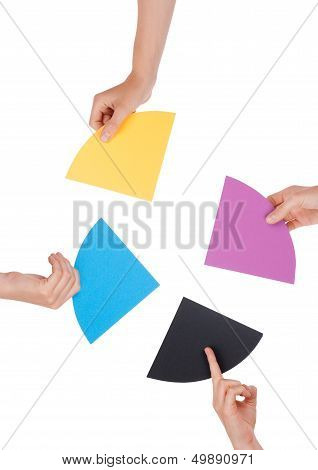 People Holding Colorful Pieces
