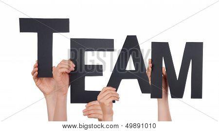 Hands Holding A Black Team