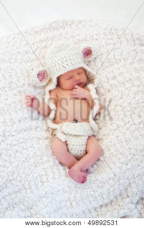 Newborn Baby Wearing A Lamb Costume