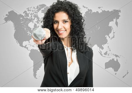 Beautiful woman holding a microphone to interview you