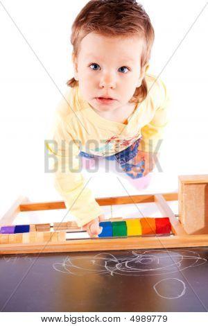 Toddler Near Blackboard