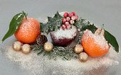 stock photo of satsuma  - Christmas decoration with apple and mandarin orange fruit over silver grey background - JPG