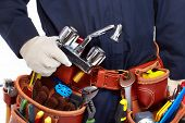 stock photo of handyman  - Handyman with a tool belt - JPG