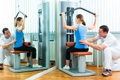 picture of physiotherapy  - Patient at the physiotherapy or physical therapy doing exercises with her therapist - JPG