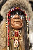 A face of an old Native American Indian in full headdress