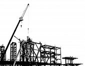 stock photo of crane hook  - Construction site with crane and scaffolding seen as a silhouette - JPG