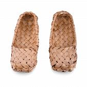 image of baste  - Old Russian bast shoes isolated on white background - JPG