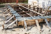 image of formwork  - wooden formwork concrete foundation of house at building yard - JPG