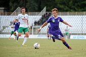 KAPOSVAR, HUNGARY - AUGUST 16: Simon Ligot (in purple) in action at a Hungarian National Championshi