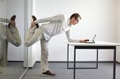 stock photo of stretching exercises  - leg exercise durrng office work  - JPG