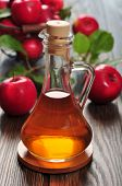 pic of vinegar  - Apple cider vinegar in glass bottle and basket with fresh apples