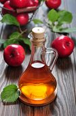 image of cider apples  - Apple cider vinegar in glass bottle and basket with fresh apples