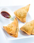 pic of samosa  - traditional indian snack food samosa with red chutney - JPG