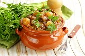 stock photo of stew pot  - Beef stew with vegetables and herbs in a clay pot - comfort food