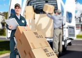 stock photo of warehouse  - Delivery courier - JPG