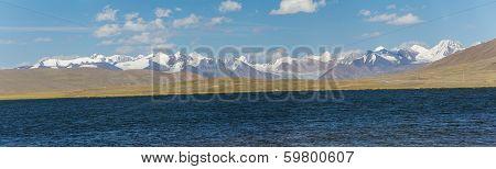 Panorama of alpine lake in TIen Shan mountains