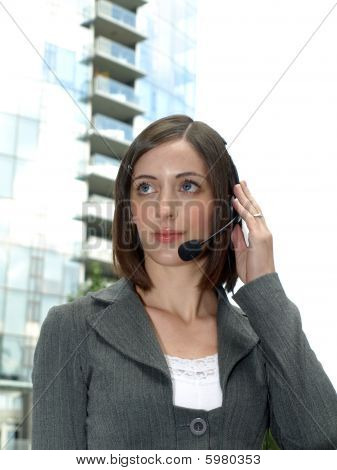 Attractive young woman with headset