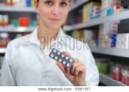 Pharmacist Selling Medicine
