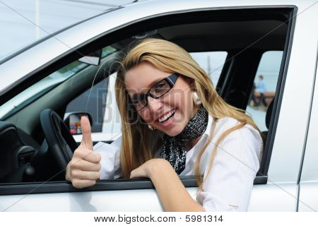 Happy Woman Driving A New Car