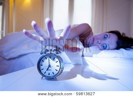 Close Up Alarm Clock With Red Haired Woman Turning It Off
