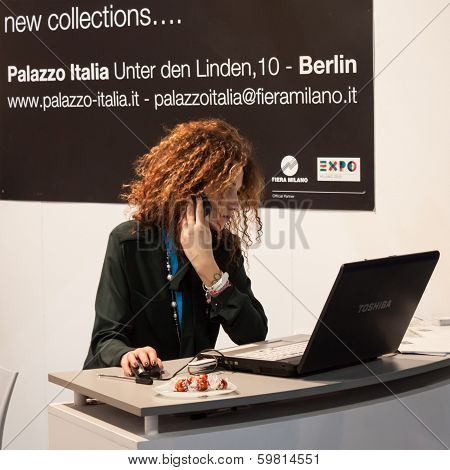 Beautiful Hostess Working At Computer At Bit 2014, International Tourism Exchange In Milan, Italy