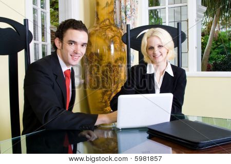 Real estate agent meeting client