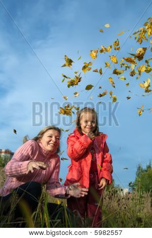 Women And Child Throw Up Yellow Leaves