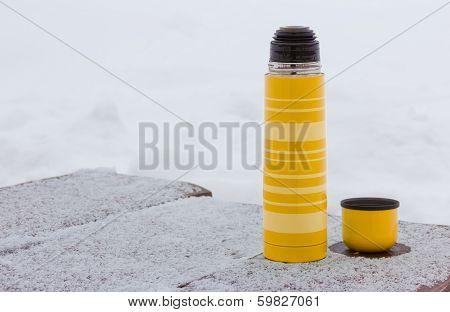 Yellow Thermos And Mug